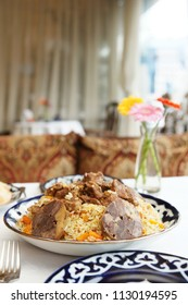 Pilaf with lamb meat, traditional Uzbek food, served in a restaurant