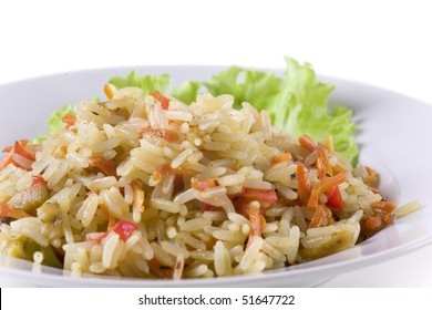 pilaf on plate decorated with leaf. close up