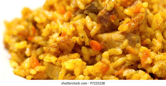 pilaf from rice and meat. It is prepared with karri and carrots