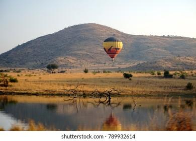 PILANESBERG, SOUTH AFRICA - CIRCA SEPTEMBER 2017: Hot air balloon above the bush at dawn