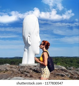 "Pilane/Tjorn, Sweden - August 2 2018: Art made by spanish artist Jaume Plensa. Named ""Anna"". Cituated in the public nature. Photographer (I) also named Anna connect with the sculpture from a distance."