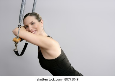 pilate instructor woman portrait in Cadillac trapeze