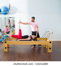 Pilates aerobic personal trainer instructor man in cadillac fitness woman exercise