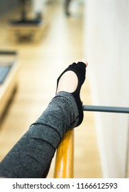Pilates and ballet fitness stretching and yoga studio gym bar equipment and dancer stretching.