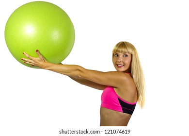 pilates.  blonde Caucasian female with a green pilates ball.