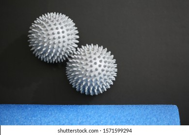 pilates equipment closeups 2 spiky silver balls black background