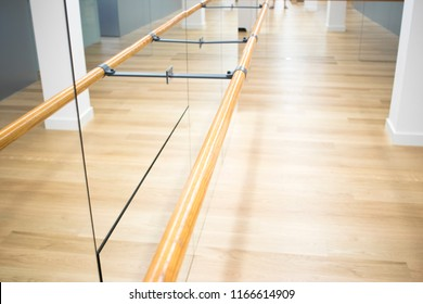 Pilates fitness studio gym room with training dance ballet bar for stretching and splits.