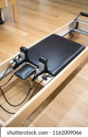 Pilates machine fitness studio gym room with training machines