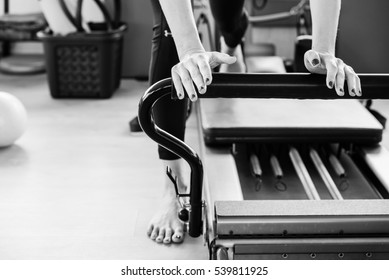 Pilates reformer exercise's detail in black and white.