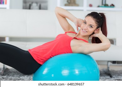 pilates woman doing fitball exercise workout at gym