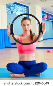 Pilates woman magic ring hands exercise workout at gym indoor