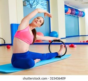 Pilates woman side stretch magic ring exercise workout at gym indoor