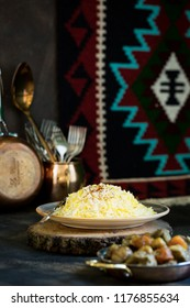Pilav or plov plate for Novruz, Azerbaijan national cuisine, cooked rice with saffron with dried fruits and meat in copper plate, spring celebration family holiday concept