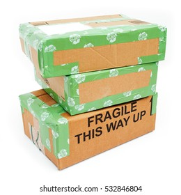 A pile of 3 wrapped up parcels on a white background, with blank labels and green recycled parcel tape