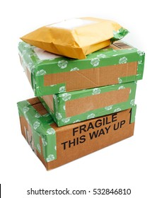 A pile of 4 wrapped up parcels on a white background, with blank labels and green recycled parcel tape