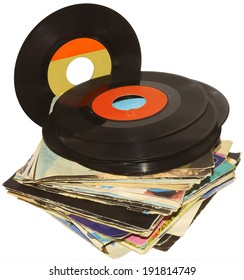 pile of 45 RPM vinyl records used and dirty even