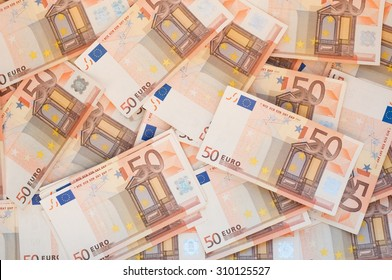 Pile of 50 euro notes - business background