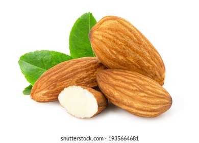 Pile of almond nuts and almond slice with green leaf isolated on white background.