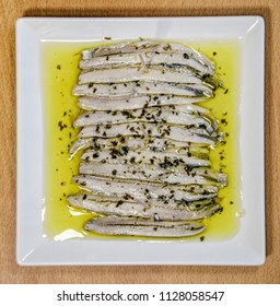 a pile of anchovies in vinegar in oil, ration type tapa typical of Spain
