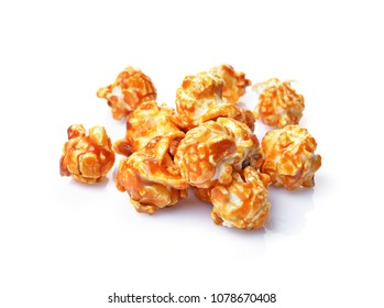 Pile of appetizing popcorn with caramel taste and flavor isolated on white background