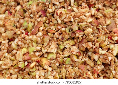 Pile of apple pieces on a compost heap, leftover from apple cider making. Background with space for text.