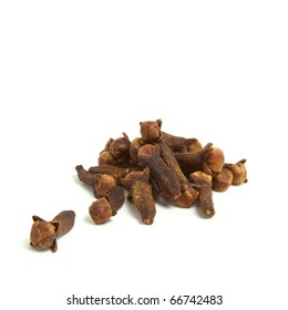 Pile of aromatic cloves from low perspective isolated on white.