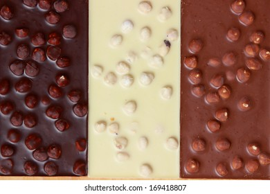 Pile of assorted chocolate bars. Top view point./different kind of chocolate