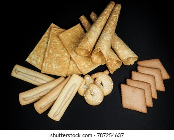 Pile of assorted norwegian traditional christmas cookies against black
