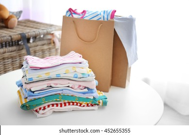 Pile of baby clothes, close up