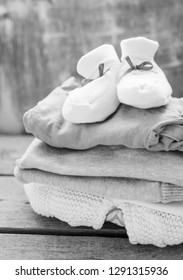 Pile of baby clothes /toned photo