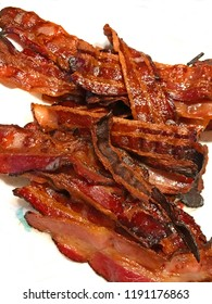 Pile of bacon on white background