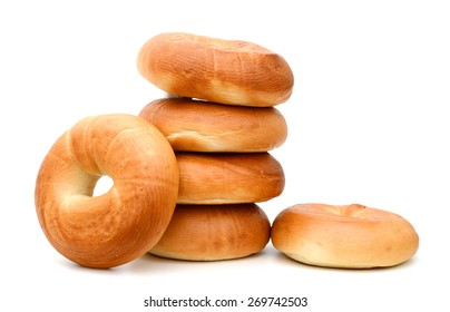 a pile of bagels on white background