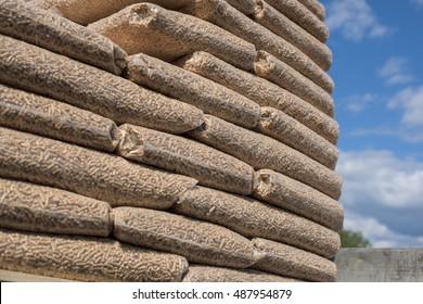 Pile of bags of coniferous pellets