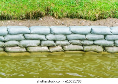 Pile of bags of sand on the river bank
