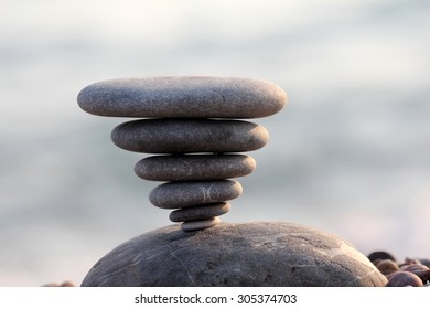 pile of balanced round stones on the beach