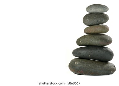 Pile of Balanced Stones in Zen-like Setting Representing Meditation. Isolated on White.