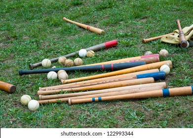 pile of baseball equipment on the grass after practice
