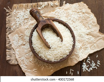 Pile of Basmati rice in a bowl with a spoon close up