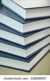 Pile of big blue books