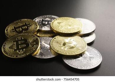 Pile of bitcoin coins on black background