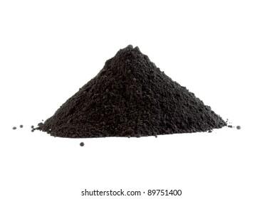 Pile of black powder isolated on white