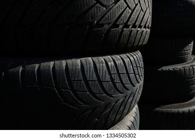Pile of blak tyres. Backdrop, background, texture