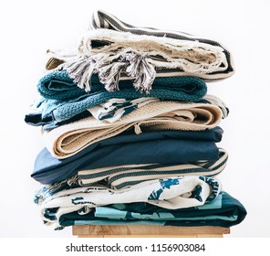 pile of blue and beige laundry 2