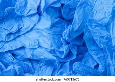 Pile of blue nitrile gloves