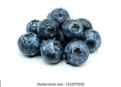 A pile of blueberries with water drops isolated on white background