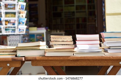 a pile of books in a bookstore