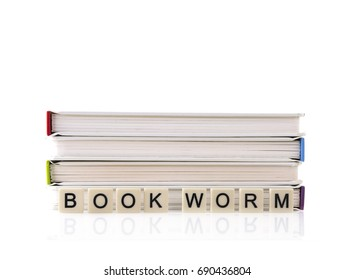 Pile of Books with Bookworm spelt out with word tiles on a white background