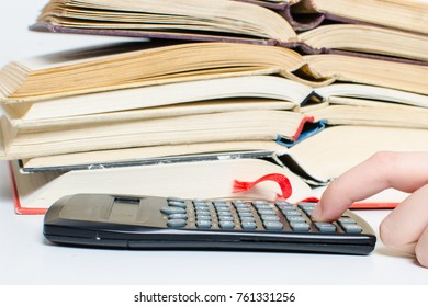 A  pile of books and a calculator help in learning.