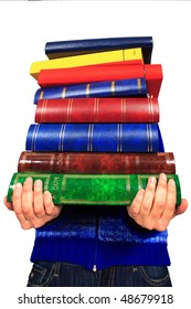 pile of books in closeup   in the hands of a woman