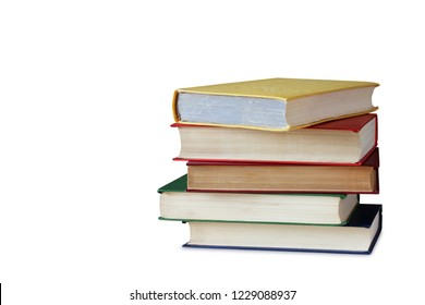 Pile of books in color covers, isolated on white background.